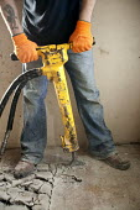 A worker uses a jackhammer on a refurbishment. - Paul Box - 13-12-2007