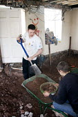 A worker shovels and sieves soil on a refurbishment. - Paul Box - 16-01-2008