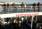 Eastern Europeans take photographs with the white cliffs of Dover as a Seafrance ferry arrives at Dover ferry port. - Paul Box - 06-01-2008