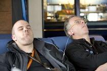 Passengers fall asleep on the ferry, Dover ferry port. - Paul Box - 30-01-2006