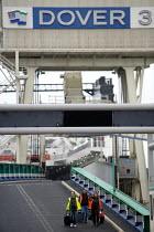 Ferry workers leaving the ship at Dover ferry port. - Paul Box - 2000s,2006,arrival,arrivals,arrive,arrived,arrives,arriving,boat,boats,capitalism,capitalist,cargo,crew,crewman,crewmen,crewmenmaritime,disembark,disembarkation,disembarking,dock,docks,dockside,EBF,Ec