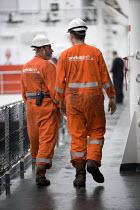Ferry workers on a Norfolk Line ship, Dover ferry port. - Paul Box - 2000s,2006,boat,boats,capitalism,capitalist,cargo,crew,crewman,crewmen,crewmenmaritime,dock,docks,dockside,EBF,Economic,Economy,ferries,ferry,harbor,harbors,HARBOUR,harbours,Industries,industry,maker,