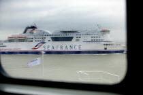 SeaFrance ferry, Dover ferry port. - Paul Box - 2000s,2006,arrival,arrivals,arrive,arrived,arrives,arriving,boat,boats,capitalism,capitalist,cargo,dock,docks,dockside,EBF,Economic,Economy,ferries,ferry,harbor,harbors,HARBOUR,harbours,Industries,ind