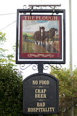 An unusual pub sign. The Plough, No food Crap beer, Bad hospitality - Paul Box - 2000s,2009,ACE,beer,cities,city,communicating,communication,culture,drink,drinker,drinkers,drinking,food,FOODS,funny,having fun,highway,holiday,holiday maker,holiday makers,holidaymaker,holidaymakers,
