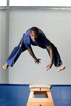 Pupil gymnast vaulting over a box at Bristol City Academy. - Paul Box - 13-05-2009