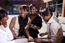 Post-16 students at Bristol City Academy. - Paul Box - 2000s,2009,adolescence,adolescent,adolescents,BAME,BAMEs,Black,BME,bmes,child,CHILDHOOD,children,cities,city,communicating,communication,conversation,dialogue,diversity,edu,educate,educating,education