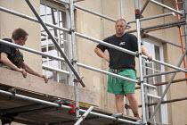 Scaffolders erecting scaffolding on a building - Paul Box - 02-09-2009