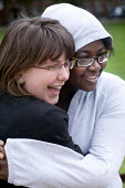 Hugging. Students relaxing outside. - Paul Box - ,2000s,2009,adolescence,adolescent,adolescents,BAME,BAMEs,black,BME,bmes,campus,CAMPUSES,cities,city,cultural,diversity,edu,educate,educating,education,educational,EMOTION,EMOTIONAL,EMOTIONS,ethnic,et
