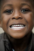 A child showing off his teeth. - Paul Box - 2000s,2009,BAME,BAMEs,Black,BME,bmes,boy,boys,child,childhood,children,cities,city,cultural,diversity,EARLY YEARS,EMOTION,EMOTIONAL,EMOTIONS,ethnic,ethnicity,face,faces,infancy,infant,infants,juvenile