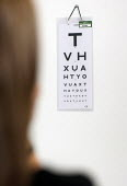 Eye test using a Snellen chart used for visual acuity testing. NHS GP surgery and walk-in service, at Boots Broadmead Medical Centre, in Bristol. - Paul Box - 02-09-2009