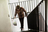 Selwood Housing residents returning with her shopping bag climbing the stairs. Selwood manage and maintain quality affordable housing and provide support services for people in housing need - Paul Box - 2000s,2009,accommodation,adult,adults,age,ageing population,bought,buy,buyer,buyers,buying,care,climbing,commodities,commodity,consumer,consumers,customer,customers,elderly,FEMALE,goods,home,homes,hou