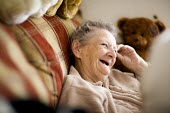 Elderly resident at a retirement home. - Paul Box - 2000s,2009,accommodation,adult,adults,age,ageing population,care,disabilities,disability,disable,disabled,disablement,elderly,EMOTION,EMOTIONAL,EMOTIONS,FEMALE,funny,happiness,happy,home,homes,housing