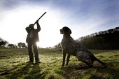 A shooting enthusiast with his gun dog and double barreled shotgun, Exmoor. - Paul Box - 12,2000s,2009,animal,animals,Barbour Jacket,blood sport,bore,canine,country,countryside,dog,dogs,enthusiasm,enthusiastic,gun,guns,hobbies,hobby,hobbyist,hunt,hunter,hunters,hunting,hunts,Leisure,LFL,L