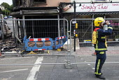 Firefighters attend a fire above a Creations Nail Salon on Gloucester Road in Bristol. - Paul Box - 2010s,2011,adult,adults,Burnt Out,cities,city,damage,damaged,DEHYDRATED,dehydration,department,DIA,drink,drinker,drinkers,drinking,Emergency Services,employee,employees,Employment,fire,fire and rescue