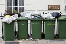 Overflowing wheelie bins as strike action by refuse collectors is preventing the bins being emptied. Southampton - Paul Box - 2010s,2011,bag,bags,bin,bin bag,bin bags,bin man,bin man binmen,bin men,binbag,binbags,binman,binmen,bins,black,cities,city,collection,collector,council service,Council Workers,disputes,dustman,dustme