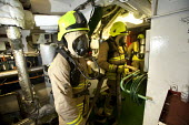 Rescue from the engine room. A cruise ship has a mock fire incident attended by the fire brigade. - Paul Box - 05-08-2011