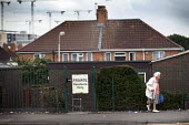 An elderly woman leaves her sheltered housing, Southmead, Bristol. - Paul Box - ,2010s,2011,adult,adults,age,ageing population,cities,city,elderly,FEMALE,home,homes,housing,Housing Estate,leaves,MATURE,OAP,OAPS,old,pavement,pedestrian,pedestrians,PENSION,pensioner,pensioners,PENS