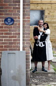 A young newly married couple outside their first home the Love Shack. Derby - Paul Box - 14-08-2011
