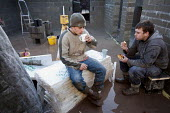 Builders having a tea break on a barn conversion. - Paul Box - 22-01-2010