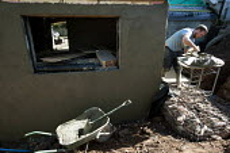 A builder renders the external walls of a barn conversion. - Paul Box - 15-03-2010