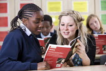 Pupils reading Macbeth, Bristol City Academy. - Paul Box - 2010,2010s,adolescence,adolescent,adolescents,BAME,BAMEs,black,BME,bmes,book,books,child,CHILDHOOD,children,cities,city,class,classroom,CLASSROOMS,communicating,communication,conversation,cultural,dia
