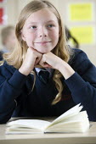Pupil at Bristol City Academy. - Paul Box - 2010,2010s,adolescence,adolescent,adolescents,book,books,child,CHILDHOOD,children,cities,city,class,classroom,CLASSROOMS,communicating,communication,edu,educate,educating,education,educational,EMOTION