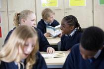 Pupils at Bristol City Academy. - Paul Box - ,2010,2010s,adolescence,adolescent,adolescents,BAME,BAMEs,black,BME,bmes,book,books,boy,boys,child,CHILDHOOD,children,cities,city,class,classroom,CLASSROOMS,communicating,communication,conversation,co