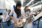 Students play the steel pan drums at Bristol City Academy. - Paul Box - 28-06-2010