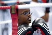 Students try boxing at Sports Week at Bristol City Academy. - Paul Box - 2010,2010s,BAME,BAMEs,Black,BME,bmes,boxer,boxers,boxing,Boxing Gloves,Boxing Match,boy,boys,child,CHILDHOOD,children,cities,city,class,combat,court,diversity,edu,educate,educating,education,education