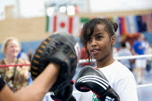Students try boxing at Sports Week at Bristol City Academy. - Paul Box - 2010,2010s,adolescence,adolescent,adolescents,BAME,BAMEs,Black,BME,bmes,boxer,boxers,boxing,Boxing Gloves,Boxing Match,child,CHILDHOOD,children,cities,city,class,combat,court,diversity,edu,educate,edu
