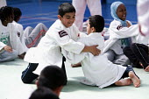 Students try judo at Sports Week at Bristol City Academy. - Paul Box - 28-06-2010