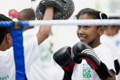 Students try boxing at Sports Week at Bristol City Academy. - Paul Box - 2010,2010s,adolescence,adolescent,adolescents,BAME,BAMEs,Black,BME,bmes,boxer,boxers,boxing,Boxing Gloves,Boxing Match,boy,boys,child,CHILDHOOD,children,cities,city,class,combat,court,diversity,edu,ed