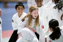 Students try judo at Sports Week at Bristol City Academy. - Paul Box - ,2010,2010s,art,BAME,BAMEs,black,BME,bmes,boy,boys,child,CHILDHOOD,children,cities,city,class,combat,court,cultural,diversity,edu,educate,educating,education,educational,EMOTION,EMOTIONAL,EMOTIONS,eth