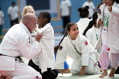 Students try judo at Sports Week at Bristol City Academy.. - Paul Box - 2010,2010s,art,BAME,BAMEs,black,BME,bmes,boy,boys,child,CHILDHOOD,children,cities,city,class,combat,court,cultural,diversity,edu,educate,educating,education,educational,EMOTION,EMOTIONAL,EMOTIONS,empl