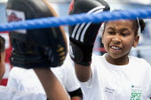 Students try boxing at Sports Week at Bristol City Academy. - Paul Box - ,2010,2010s,adolescence,adolescent,adolescents,anger,angry,BAME,BAMEs,Black,BME,bmes,boxer,boxers,boxing,Boxing Gloves,Boxing Match,child,CHILDHOOD,children,cities,city,class,combat,court,diversity,ed