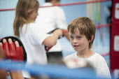 Students try boxing at Sports Week at Bristol City Academy. - Paul Box - 2010,2010s,boxer,boxers,boxing,Boxing Gloves,Boxing Match,boy,boys,child,CHILDHOOD,children,cities,city,class,combat,court,edu,educate,educating,education,educational,female,females,fight,fighting,fig