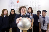Pupils using the Van de Graaff generator in a science lesson, the static electricity makes the hair stand on end. Bristol City Academy. - Paul Box - 23-03-2010