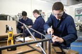 Pupils filing metals in a ITC design technology lesson at Bristol City Academy. - Paul Box - 23-03-2010