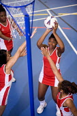 Netball team at Bristol City Academy. - Paul Box - 2010,2010s,adolescence,adolescent,adolescents,ball,balls,BAME,BAMEs,Black,BME,bmes,child,CHILDHOOD,children,cities,city,class,court,diversity,edu,educate,educating,education,educational,ethnic,ethnici