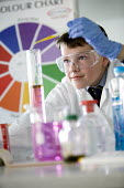 Pupil at Bristol City Academy. - Paul Box - ,2010,2010s,adolescence,adolescent,adolescents,beaker,beakers,boy,boys,chart,child,CHILDHOOD,children,cities,city,class,classroom,CLASSROOMS,coat,coats,COLOR,colorful,colorfull,colors,colour,colourful