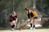 Pupils playing hockey at Clevedon School. - Paul Box - 2010,2010s,adolescence,adolescent,adolescents,ball,balls,child,CHILDHOOD,children,Comprehensive School,edu,educate,educating,education,educational,female,females,Field,game,games,girl,girls,hockey,juv