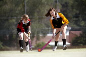 Students playing hockey, Clevedon school - Paul Box - ,2010,2010s,adolescence,adolescent,adolescents,ball,balls,child,CHILDHOOD,children,Comprehensive School,edu,educate,educating,education,educational,female,females,Field,game,games,girl,girls,hockey,ju