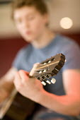 6th form pupil playing a guitar at Clevedon School. - Paul Box - 23-06-2010