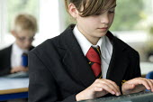 Pupils using an electronic tablet in lesson at Clevedon School. - Paul Box - 23-06-2010