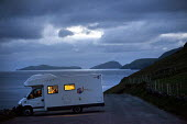 Family camping overnight in a motorhome, parked up in a car park, Dingle peninsula. Ireland - Paul Box - 16-08-2010