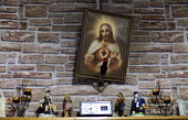 A picture of Jesus Christ over a mantlepiece at a home. Kerry, Ireland - Paul Box - 20-08-2010
