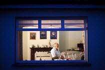 A disabled man watching TV at home. Kerry, Ireland - Paul Box - Irish,2010,2010s,ACE,age,ageing population,alone,bound,Culture,diabetes,diabetic,diabetics,disabilities,disability,disable,disabled,disablement,elderly,eu,Europe,european,europeans,eurozone,hea,health