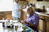 A diabetic disabled man injects insulin at home, Kerry, Ireland - Paul Box - , Irish,2010,2010s,adult,adults,age,ageing population,bound,breakfast,care,diabetes,diabetic,diabetics,disabilities,disability,disable,disabled,disablement,eat,eating,elderly,eu,Europe,european,europe