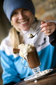 A mountain biker has a hot chocolate Redruth, Cornwall - Paul Box - 2000s,2009,drink,drinks,FEMALE,holiday,holiday maker,holiday makers,holidaymaker,holidaymakers,holidays,hot,Leisure,LFL,LIFE,PEOPLE,person,persons,RECREATION,RECREATIONAL,relaxation,relaxed,relaxing,t