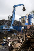 Loading containers with recycled metal for India and Brazil. SITA metal recycling facility at Boreham, Chelmsford. - Paul Box - 26-04-2010